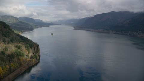 AX153_185.0000354F - Aerial stock photo of The wide river in the Columbia River Gorge, Oregon