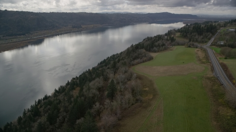AX153_188.0000347F - Aerial stock photo of Cliff top trees overlooking the Columbia River, Washington