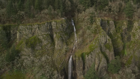 AX154_011.0000174F - Aerial stock photo of A waterfall on a steep cliff in Columbia River Gorge, Washington