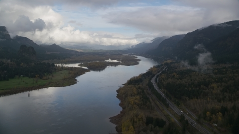AX154_024.0000000F - Aerial stock photo of Columbia River and I-84 near Columbia River Gorge islands