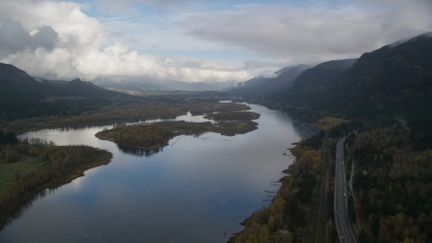 AX154_025.0000144F - Aerial stock photo of I-84 and islands in the Columbia River Gorge