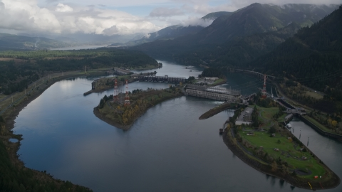 AX154_029.0000000F - Aerial stock photo of Columbia River and the Bonneville Dam in Columbia River Gorge