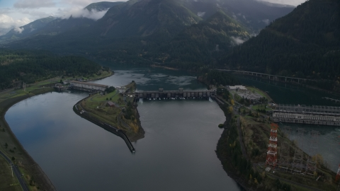 AX154_030.0000196F - Aerial stock photo of Bonneville Dam in the Columbia River Gorge