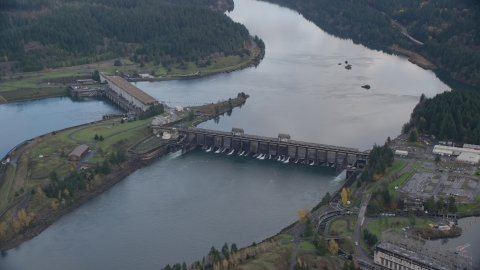 AX154_038.0000311F - Aerial stock photo of Bonneville Dam structures in the Columbia River Gorge