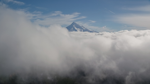 AX154_061.0000000F - Aerial stock photo of Clouds and the summit of Mount Hood, Cascade Range, Oregon