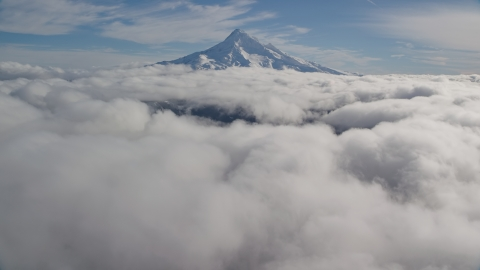 AX154_066.0000000F - Aerial stock photo of The snowy summit and a blanket of clouds, Mount Hood, Cascade Range, Oregon