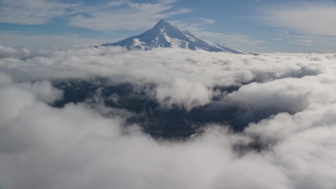 AX154_067.0000251F - Aerial stock photo of The Mount Hood summit with snow and clouds, Cascade Range, Oregon