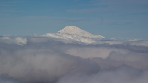 AX154_069.0000000F - Aerial stock photo of Mt Adams' snowy summit in the distance and low cloud cover, Cascade Range, Oregon