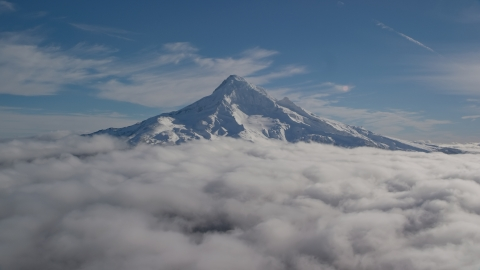 AX154_070.0000000F - Aerial stock photo of The summit of Mount Hood with snow and low clouds, Mount Hood, Cascade Range, Oregon