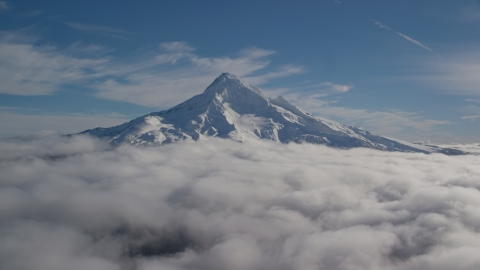 AX154_070.0000206F - Aerial stock photo of Mount Hood's snowy summit with low clouds, Mount Hood, Cascade Range, Oregon