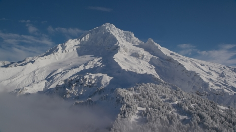 AX154_079.0000219F - Aerial stock photo of Mount Hood covered in snow in the Cascade Range, Oregon