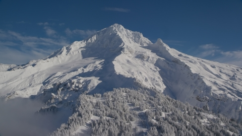 AX154_080.0000000F - Aerial stock photo of Snow-covered slopes of Mount Hood, Cascade Range, Oregon
