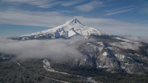 AX154_108.0000000F - Aerial stock photo of Low clouds over snowy forest near Mount Hood, Cascade Range, Oregon