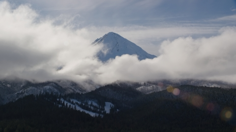 AX154_131.0000000F - Aerial stock photo of Clouds around the snowy summit of Mount Hood, Cascade Range, Oregon