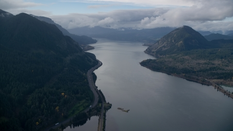 AX154_157.0000279F - Aerial stock photo of The Columbia River and the I-84 highway in Columbia River Gorge
