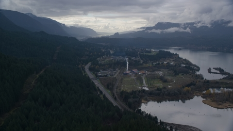 AX154_165.0000339F - Aerial stock photo of I-84 and the small town of Cascade Locks, Oregon in Columbia River Gorge