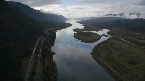 AX154_179.0000286F - Aerial stock photo of The Columbia River and I-84 highway near islands in Columbia River Gorge