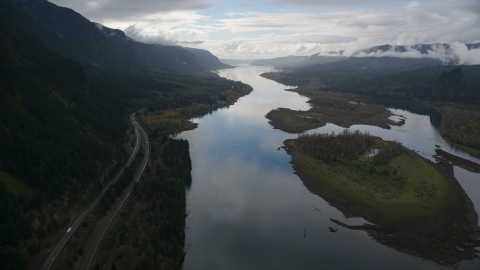 AX154_180.0000321F - Aerial stock photo of Columbia River and the I-84 highway by islands in the Columbia River Gorge