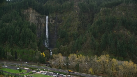 AX154_189.0000297F - Aerial stock photo of I-84 highway by Multnomah Falls on a cliff face of the Columbia River Gorge