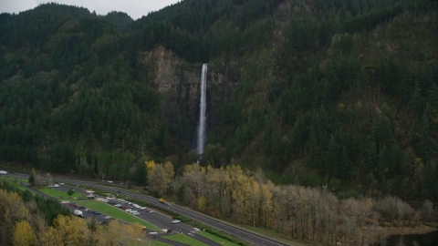AX154_189.0000367F - Aerial stock photo of Interstate 84 and Multnomah Falls on a cliff face of the Columbia River Gorge