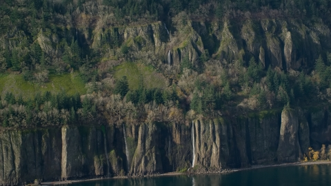 AX154_194.0000136F - Aerial stock photo of Four waterfalls on steep green cliffs on the Washington side of Columbia River Gorge