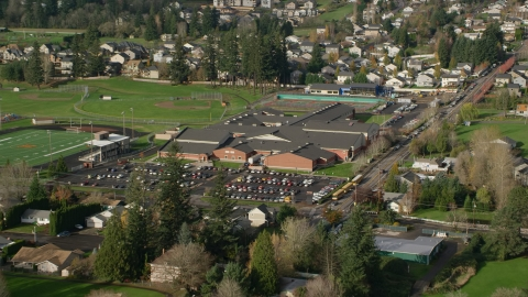 AX154_202.0000125F - Aerial stock photo of Washougal High School in Washougal, Washington