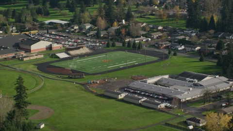 AX154_204.0000156F - Aerial stock photo of Gause Elementary and the Washougal High School football field in Washougal, Washington