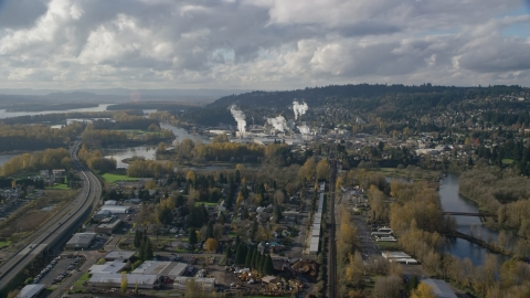 AX154_210.0000271F - Aerial stock photo of Homes near the Washougal River and the Georgia Pacific Paper Mill in Camas, Washington