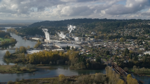 AX154_211.0000254F - Aerial stock photo of The Washougal River and the Georgia Pacific Paper Mill in Camas, Washington
