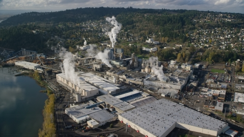 AX154_213.0000037F - Aerial stock photo of Steam rising from the Georgia Pacific Paper Mill in Camas, Washington