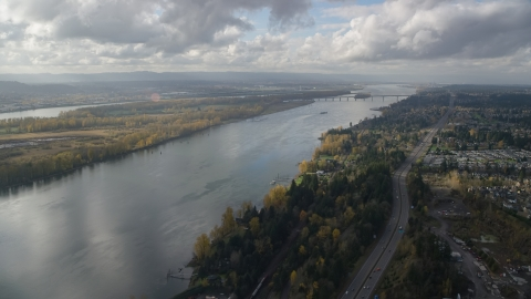 AX154_215.0000243F - Aerial stock photo of Highway 14 and the Columbia River near the I-205 Bridge in Vancouver, Washington
