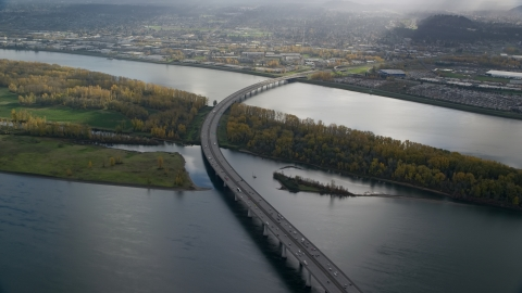AX154_218.0000275F - Aerial stock photo of I-205 Bridge and the Columbia River with godrays shining down, Vancouver, Washington