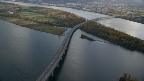 AX154_219.0000231F - Aerial stock photo of I-205 Bridge spanning the Columbia River, Vancouver, Washington