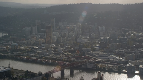AX154_226.0000265F - Aerial stock photo of Godrays shining down on the Willamette River and Downtown Portland, Oregon