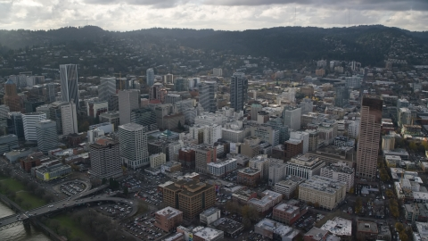 AX154_237.0000115F - Aerial stock photo of City buildings near US Bancorp Tower in Downtown Portland, Oregon