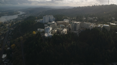 AX154_247.0000166F - Aerial stock photo of The Oregon Health and Science University complex in the hills over Portland, Oregon