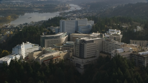 AX154_248.0000000F - Aerial stock photo of Oregon Health and Science University hospital complex in the hills over Portland, Oregon