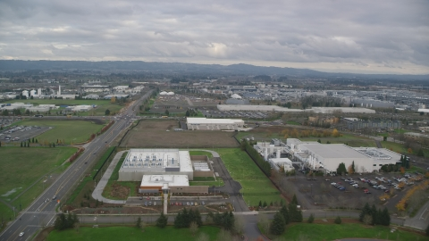 AX155_001.0000184F - Aerial stock photo of Jireh Semiconductor plant in Hillsboro, Oregon