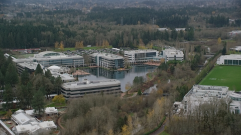 AX155_011.0000118F - Aerial stock photo of Nike Headquarters office buildings in Beaverton, Oregon