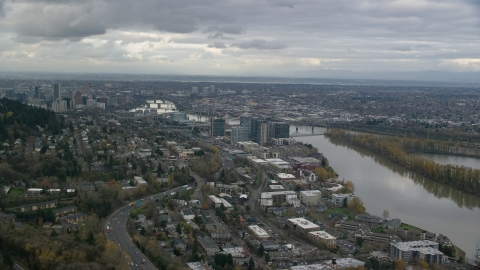 AX155_019.0000282F - Aerial stock photo of Condo high-rises by the Willamette River in South Waterfront, Downtown Portland, Oregon