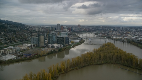 AX155_026.0000098F - Aerial stock photo of Willamette River and Ross Island, South Waterfront and Downtown Portland, Oregon