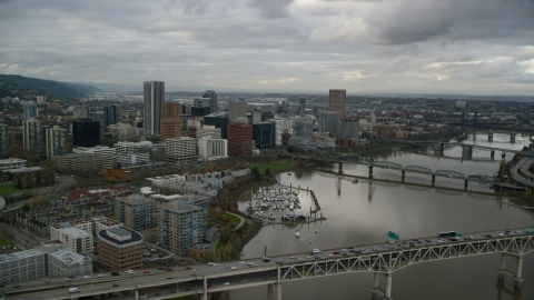AX155_028.0000228F - Aerial stock photo of Marquis Bridge, Riverplace Marina and Downtown Portland, Oregon
