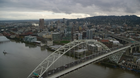 AX155_035.0000270F - Aerial stock photo of Fremont Bridge near skyscrapers in Downtown Portland, Oregon