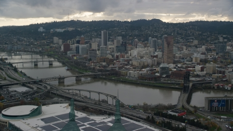 AX155_041.0000116F - Aerial stock photo of Downtown Portland, Oregon, across the Willamette River