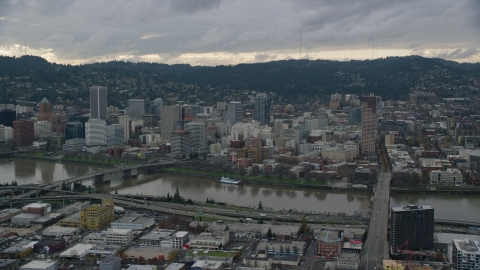 AX155_043.0000000F - Aerial stock photo of Bridges over the Willamette River and Downtown Portland, Oregon