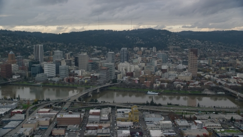 AX155_043.0000227F - Aerial stock photo of Bridges over the Willamette River and Downtown Portland, Oregon