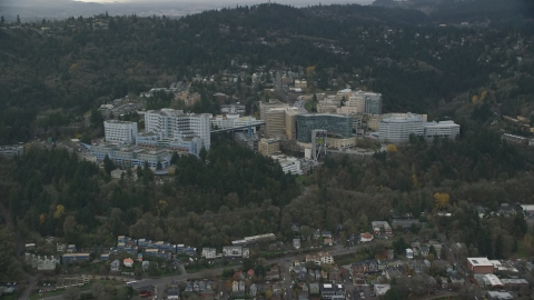 AX155_080.0000049F - Aerial stock photo of The Oregon Health and Science University in the hills over Portland, Oregon