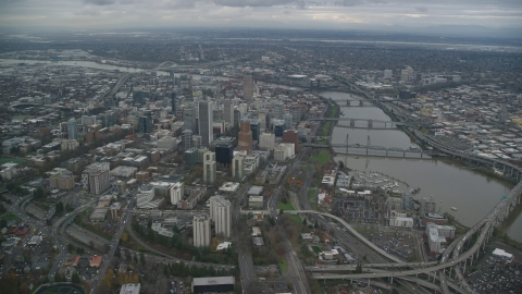 AX155_081.0000209F - Aerial stock photo of Downtown Portland cityscape and the Willamette River in Oregon