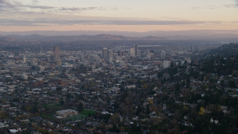 AX155_141.0000349F - Aerial stock photo of Downtown Portland at sunset, seen from hillside houses in Northwest Portland, Oregon