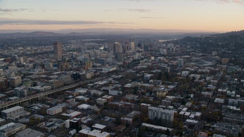 AX155_143.0000304F - Aerial stock photo of Northwest Portland at sunset, I-405 and Downtown Portland, Oregon